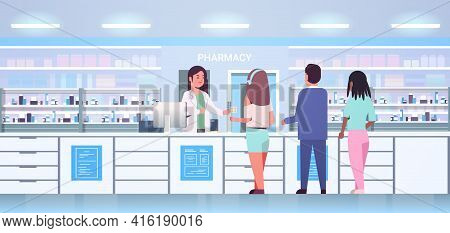 Female Doctor Pharmacist Giving Pills To Mix Race Customers Patients At Pharmacy Counter Modern Drug