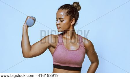 Woman weightlifting with a dumbbell