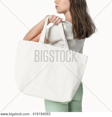 Woman with white tote bag mockup