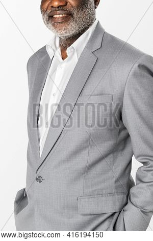 African American businessman in gray suit studio portrait