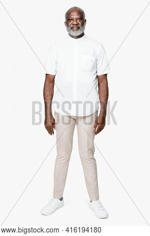Man in collarless white shirt apparel shoot