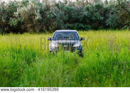 Russia, Rostovskaya Oblast - June 10, 2020: Suv Honda Crv 4x4, Black Colour In Wild Nature. Travel A