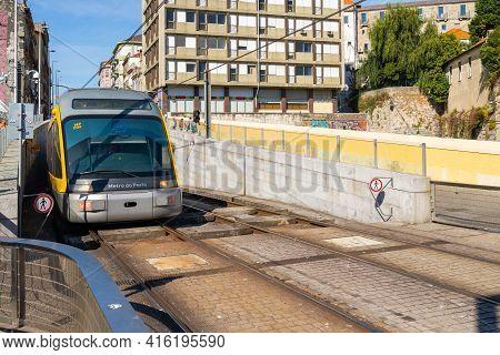 Porto, Portugal, October 06, 2018: Porto Oporto Metro Subway Tram Rain Train Railway Rail At Bridge