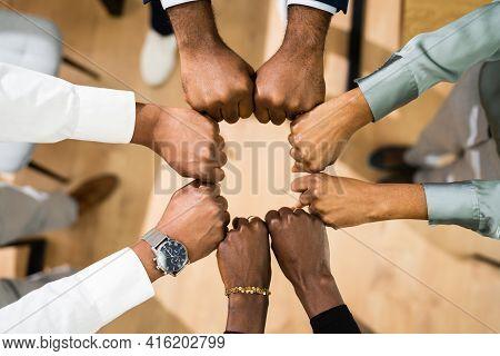 African Team Team. Many Hands Fist Bump