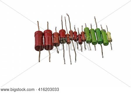 Row Of Color-coded Vintage Metal-film Resistors With Leads For Through-hole Mounting. Isolated, With