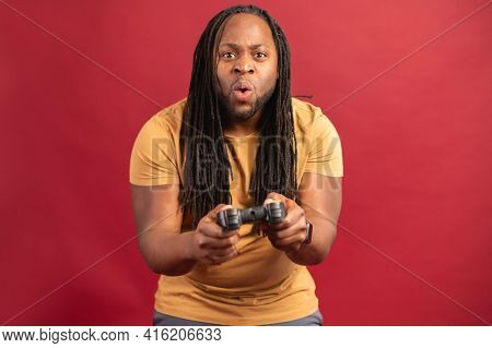 Black Passionate African-american Inspired Man With Long Dreadlocks, Dressed In Casual Clothes, Play