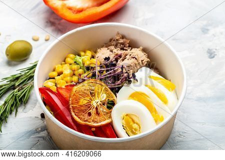 Tuna Salad With Tomatoes, Corn Olives, Eggs And Microgreen In Paper Bowl Package For Take Away Or Fo