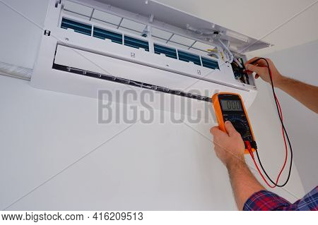 Air Conditioner Repair And Maintenance. The Engineer Diagnoses The Electrical Part Of The Indoor Uni