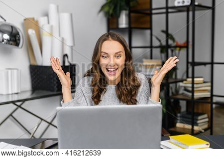 Overjoyed Young Woman Surprised Victory Looks At The Laptop Sitting In The Office, Female Celebrates