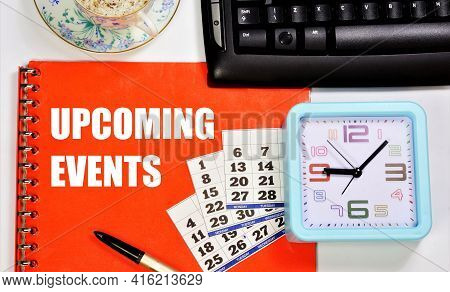 Upcoming Events. Text Label In The Folder On The Background Of The Clock And Calendar. Planning Stra