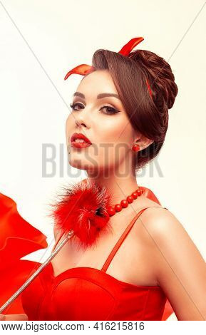 Portrait Of Sexy Young Pin-up Woman In Red Clothes With Red Lips. Beautiful Housewife. On White Isol
