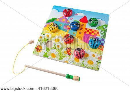We Catch Ladybirds With A Magnetic Rod. Material Tree. Educational Toy Montessori. White Background.