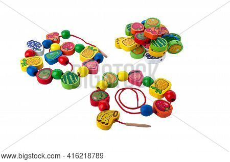 Children's Beads On A String. Wooden Construction Set. Educational Toy Montessori. White Background.