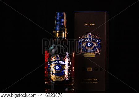 Chivas Regal 18 Is Blended From Whiskies Matured For At Least 18 Years. Whisky Bottle On Barrel. Ill