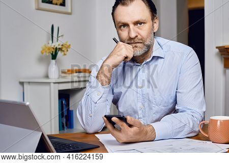 Businessman Work From Home. Businessman Work On Laptop With Cellphone From Home. Work From Home. Bus