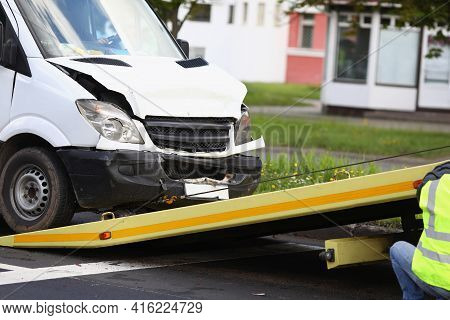 Wrecked White Car Pulling Into Tow Truck