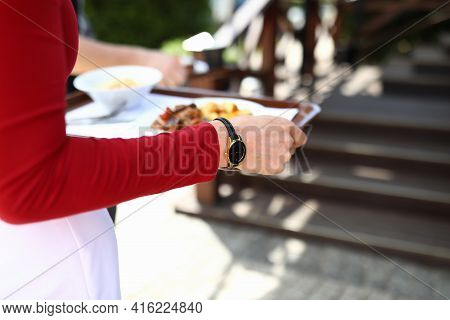 Female Waiter Carrying Food On Tray Closeup