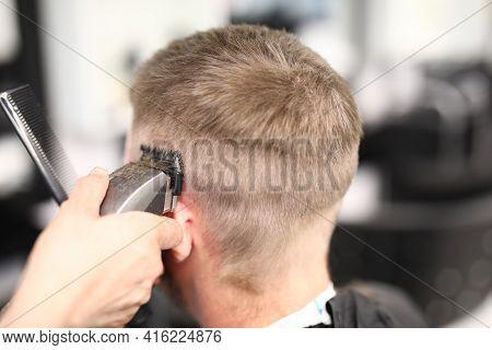 Hairdresser Holding Hair Clipper Near Man Head Closeup