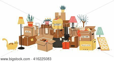 Moving To A New Home. The Family Moved To A New Home. Paper Cardboard Boxes With Various Household I