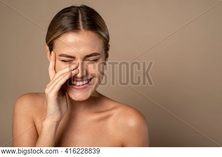 Skin Care. Woman With Beauty Face Touching Healthy Facial Skin. Beautiful Smiling Caucasian Female M
