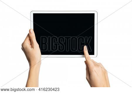Close up of woman hands holding digital tablet horizontally isolated on white background. Female hands using digital tablet with blank black screen. Detail of girl hand pointing empty screen.