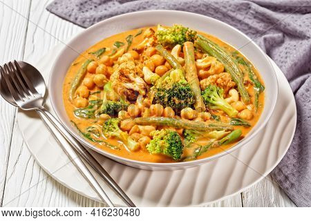 Vegetarian Coconut Curry With Chickpea, Green Beans, Cauliflower And Broccoli Florets In A Bowl On A