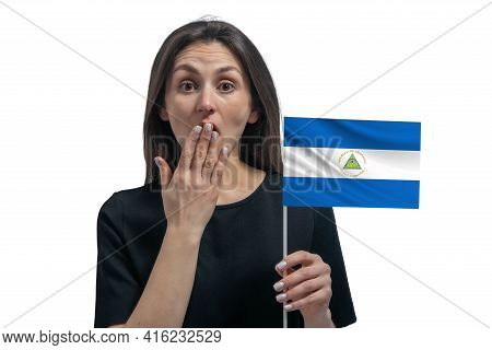 Happy Young White Woman Holding Flag Of Nicaragua And Covers Her Mouth With Her Hand Isolated On A W