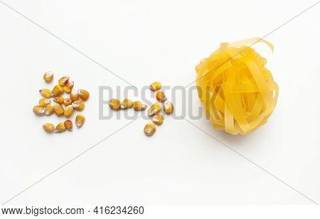 Tagliatelle Corn Paste. Gluten-free Corn Paste And Corn Grains On A White Background.