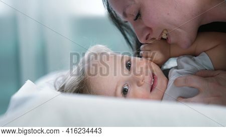 Baby Son. Mom A Kissing Baby Son On The Bed. Mom And Baby Love And Care Concept Happy Family. Mom Ki