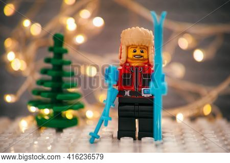 Tambov, Russian Federation - January 17, 2021 Lego Skier Minifigure With Skis Against Christmas Tree