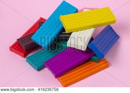 Multi-colored Plasticine On A Pink Background. Educational Game. Plasticine Set