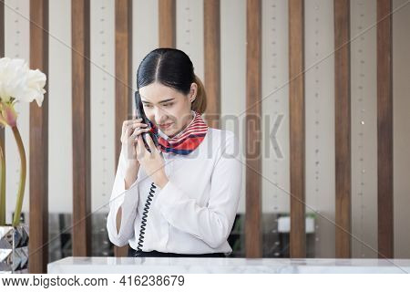 Welcome To The Hotel,happy Young Asian Woman Hotel Receptionist Worker Smiling Standing,she Taking T