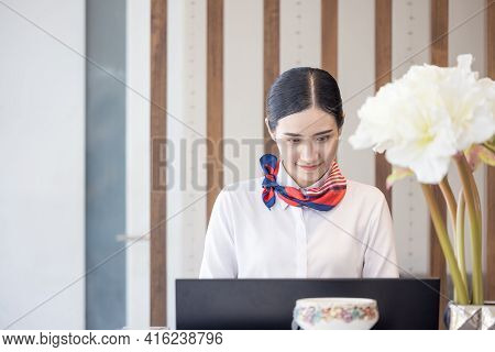 Hotel Women Working As Professional Receptionists Behind The Counter