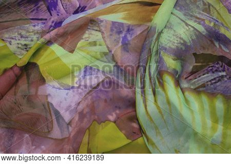 Silk Texture. Closeup Of A Beautifully Folded Multicolored Silk Scarf Or Headscarf With A Pattern.