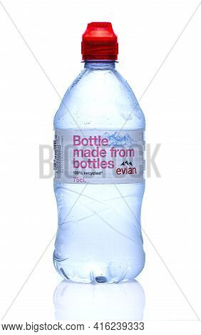 Swindon, Uk - April 9, 2021: Bottle Of Evian Natural Mineral Water 100% Recycled On A White Backgrou