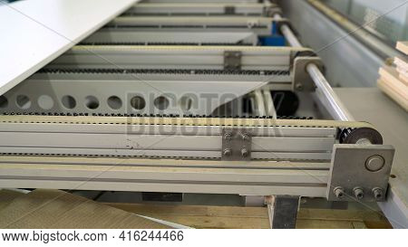 Production Line On Furniture Factory. Production Of Furniture Edging Detail. Plywood On A Machine In
