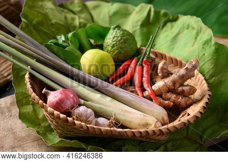 Thai Food Ingredients, Spices And Herbs For Cooking In A Bamboo Basket On Green Leaf, Organic Vegeta