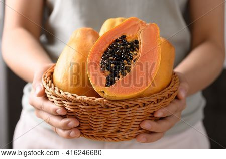 Ripe Papaya Fruit In A Basket Holding By Woman Hand, Tropical Fruit
