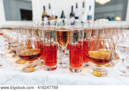 Table Setting For A Holiday Or Party. Glasses For Spirits, Champagne And Juice. Whiskey-cola Drink.