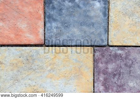 Cobblestone Pavers Abstract Mosaic Background. Colored Cobble Stone Texture. Close-up Of Street Pave