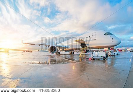 Passenger Commercial Aircraft Parked With A Wet Apron At The Airport During Service Maintenance Even