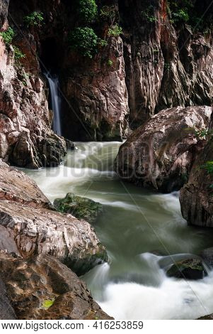 Rocky River Banks With White Water Rapids