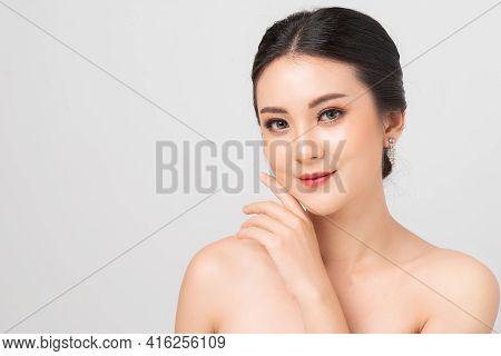 Beautiful Makeup Asian Woman. Portrait Asian Girl In Studio White Background. Cosmetic Contact Lense