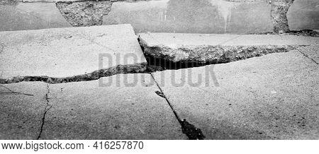 Broken sidewalk concrete crack dangerous cracked