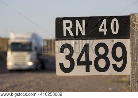 Distance Sign Road And Truck On Paved Road On The Famous Ruta 40 (route 40) Near The Town Of San Jua