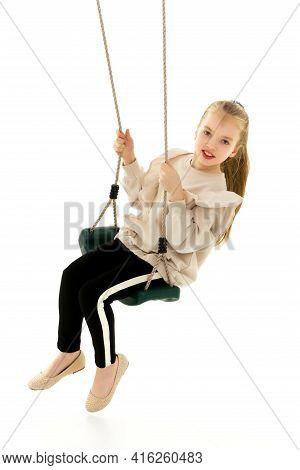 Beautiful Teen School Girl Swinging On A Swing. Concept Summer Vacation.