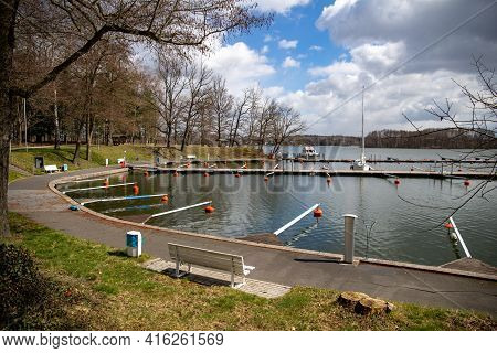 Empty Docks In The Port Of Scharmuetzelsee, Brandenburg, Germany. Empty Docks In Spring In The Open