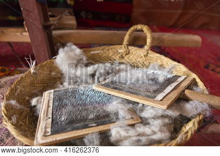 Detail Of Sheep Wool Brush To Comb In A Wicker Basket, Found In A Traditional Shop In Ait-ben-haddou