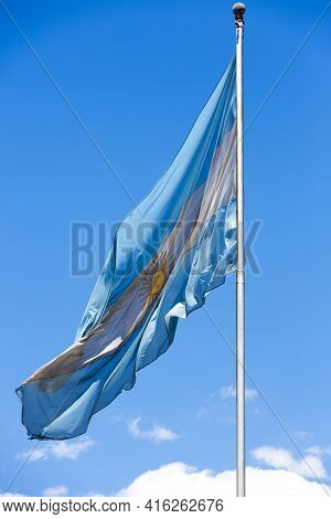 Waving Flag From Argentina With Clear Blue Sky In The Background In Buenos Aires.