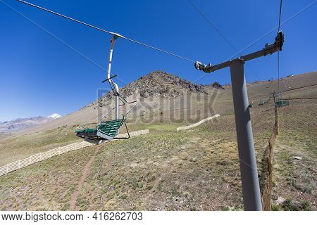 Running Empty Ski Lifts At Penitentes In The Aconcagua National Park During The Summer With Andean M